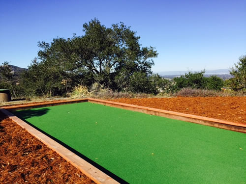 A beautiful Hybrid Bocce Court with A Stunning View of trees and hilltop space in the background.