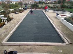 Leveling the new bocce ball court surface