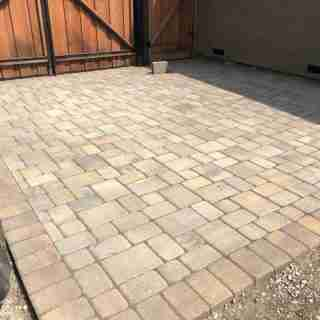 An extra paver area that extends our driveway and adds parking behind the fence.