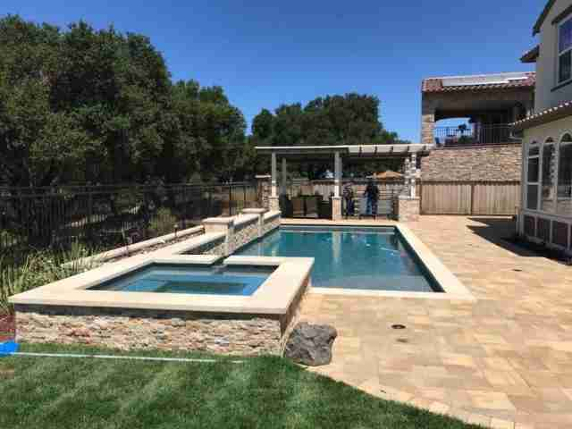 Project: Pavers, Patio Cover, Veneer Stone Retaining Wall, Bocce Court, Life Sized Chess Board – Hayward